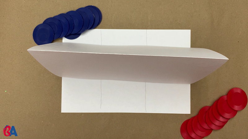 Paper divider set up between two stacks of tokens