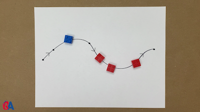 An arrangement of red and blue pieces on a curvy line
