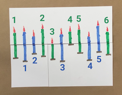 Six green candles and five blue candles