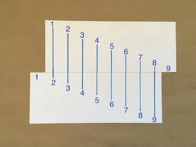 Eight numbered lines drawn on a piece of paper