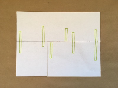 Six green rectangles on a piece of paper