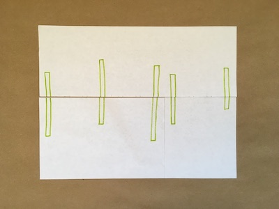 Five green rectangles on a piece of paper