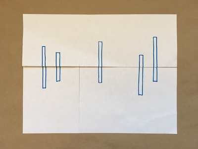 Five blue rectangles on a piece of paper