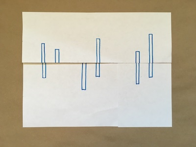 Six blue rectangles on a piece of paper