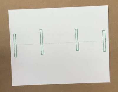 Four green rectangles drawn on a paper