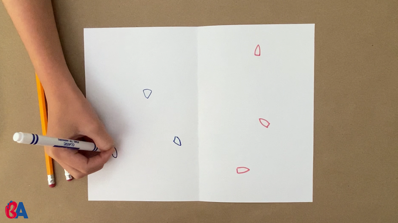 Drawing small blue and red boats on each side of a folded paper