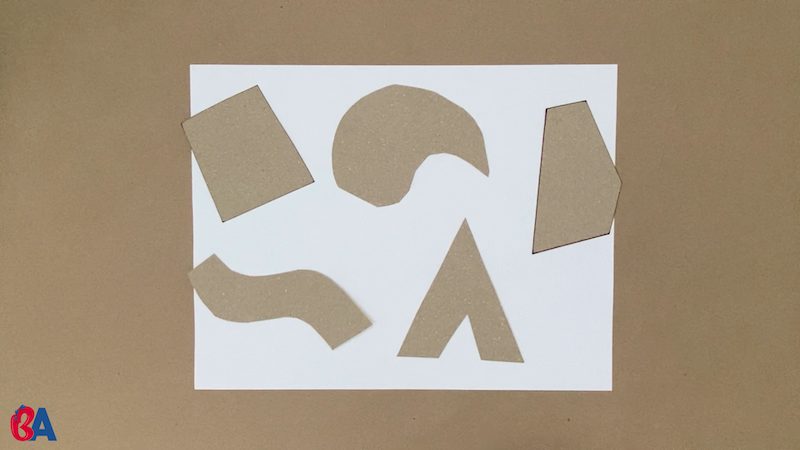 Cardboard shapes covering a piece of paper