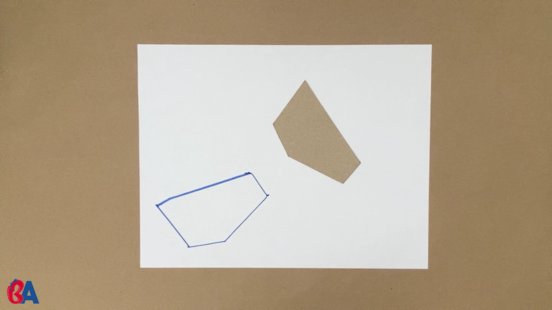 Tracing a shape on the piece of paper