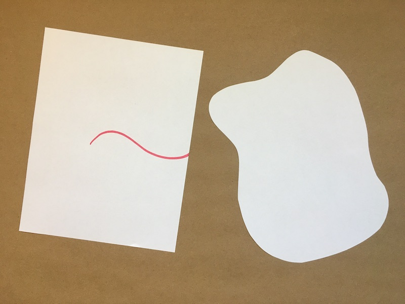 Cut pieces of paper with a line drawn