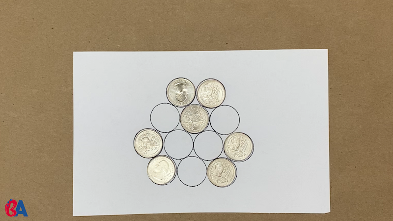 Coins arranged on a paper