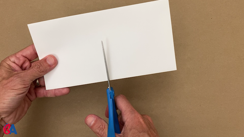Cutting a sealed envelope in half