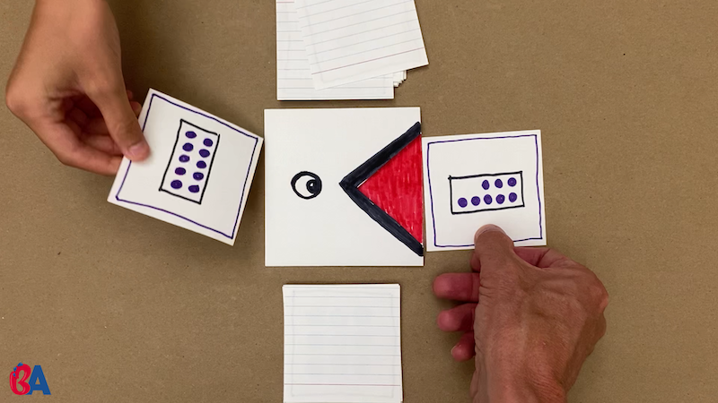 The cards are turned over and compared