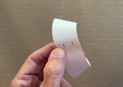 Mobius strip with two dashes drawn on it