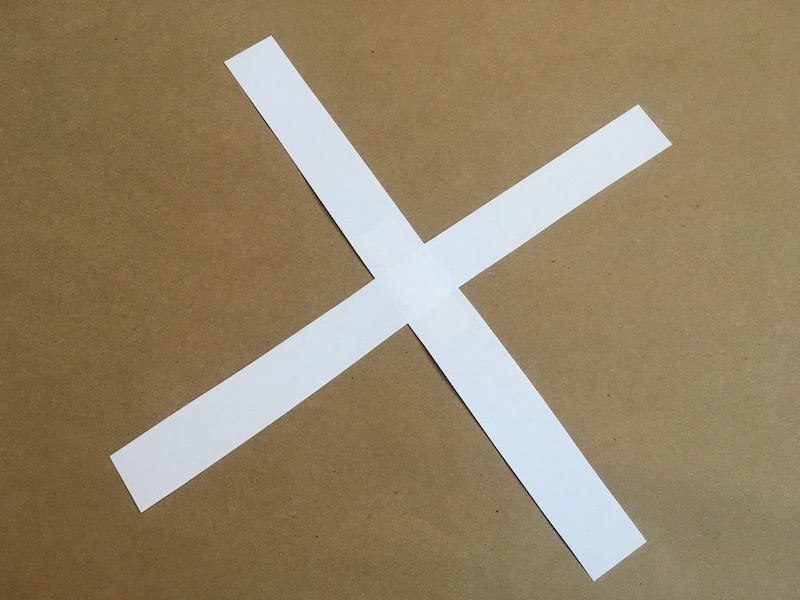 Two strips of paper taped together in a plus sign shape