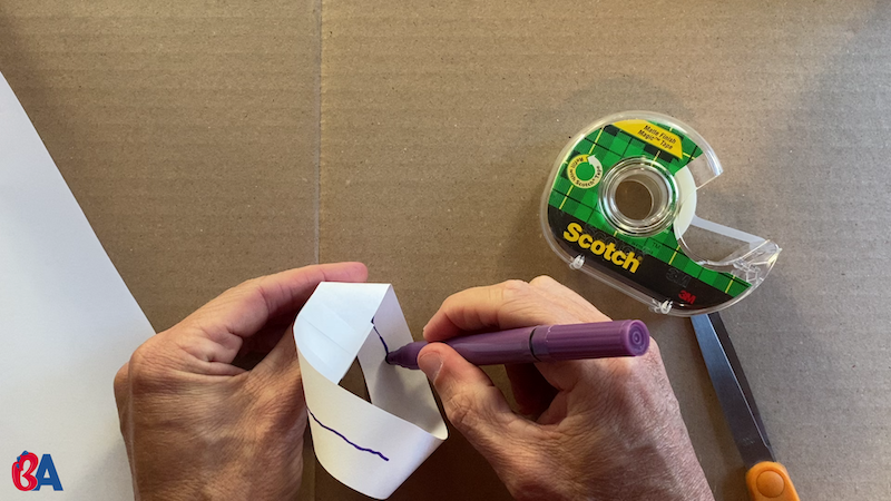 Drawing a line down the center of a mobius strip