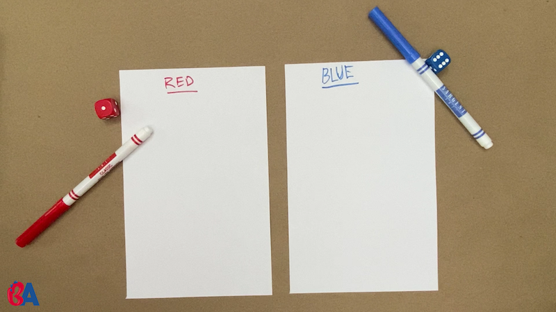 Two pieces of paper with names written at the top in red and blue