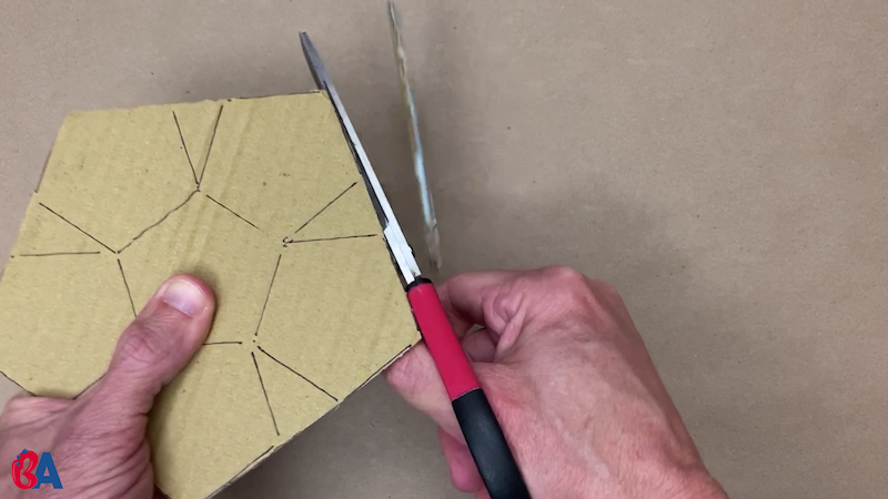 Cutting out the pentagon shapes