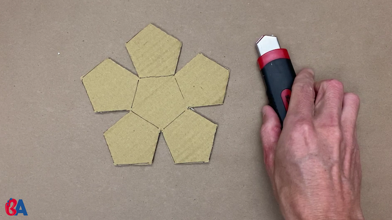 Pentagon shapes next to a knife