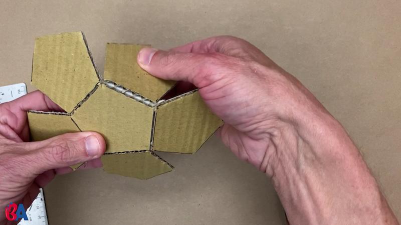 Folding over the scored pentagons