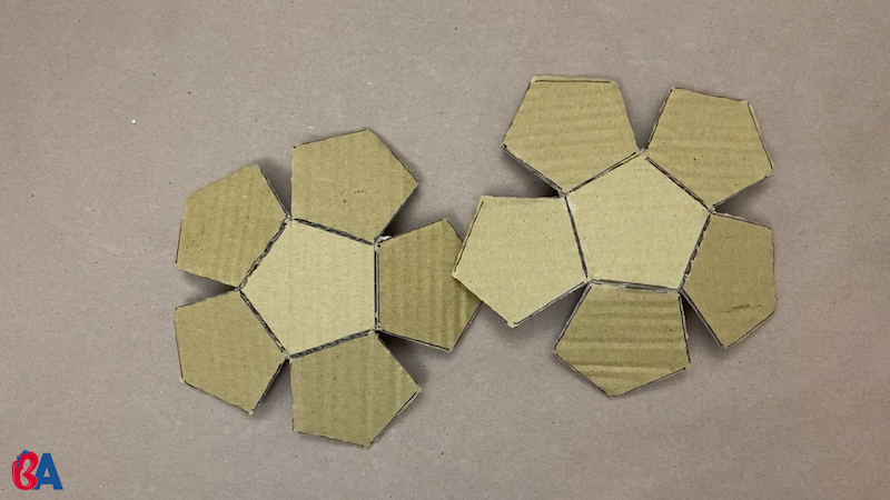 Two cardboard halves of a dodecahedron