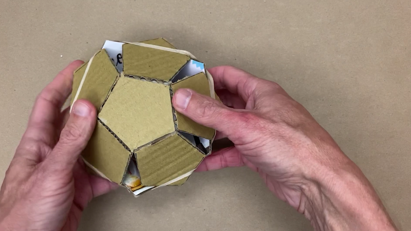 Pushing the cardboard pentagons into a dodecahedron