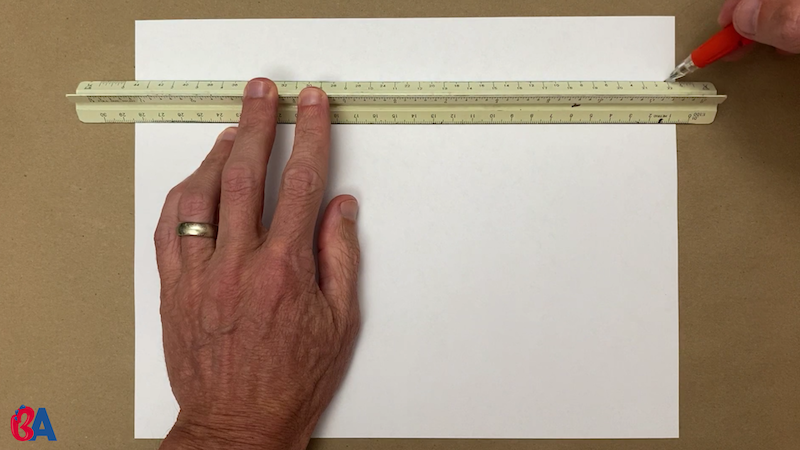 Drawing a line across a paper with a ruler