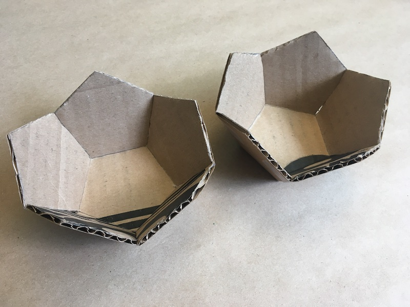 Two halves of a cardboard dodecahedron