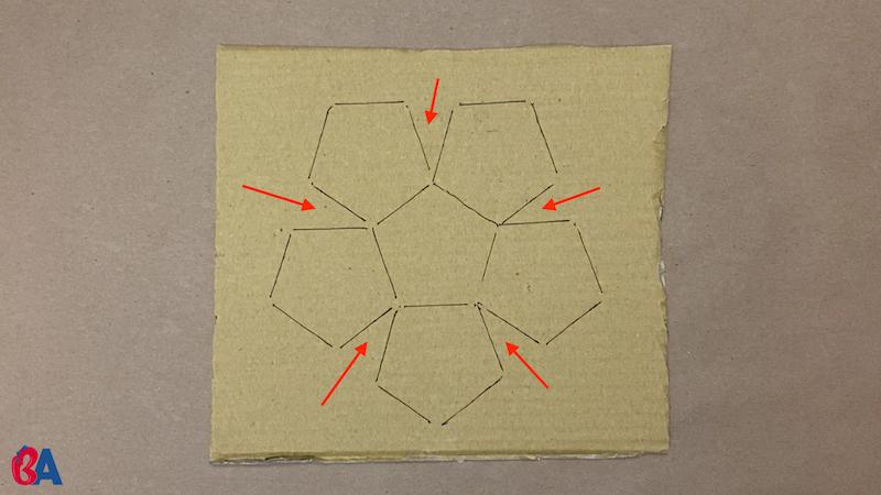 Pentagons on cardboard