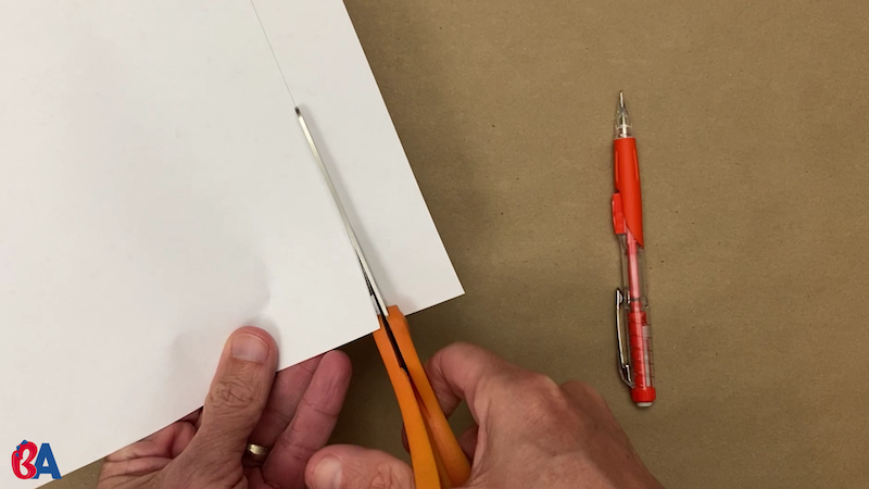 Cutting across the line to make a strip of paper