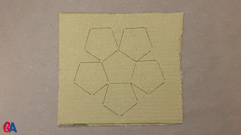 Pentagons traced onto cardboard