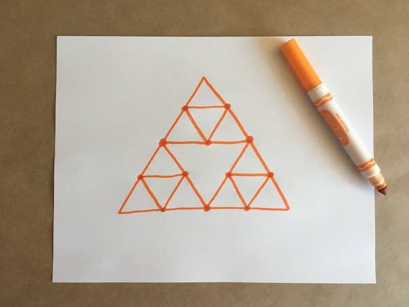 Triangles drawn on a piece of paper