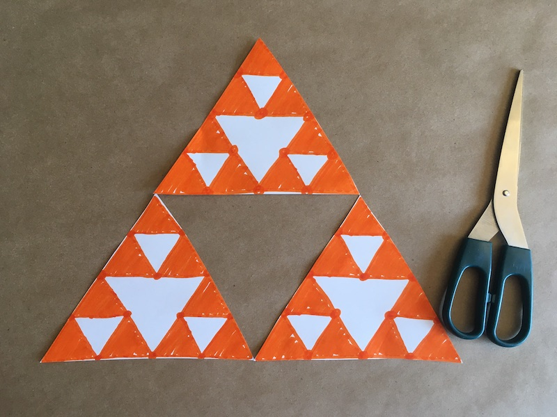 Triangles cut out making a Sierpinski Triangle
