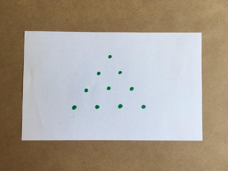 Ten dots drawn in a triangular grid