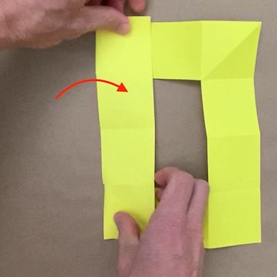 Folding the left side of the paper over