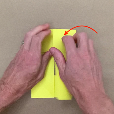 Folding the right side of the paper over