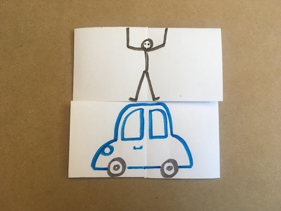 Flexagon with person standing on top of car