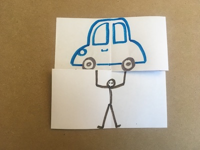 Flexagon with person holding up a car