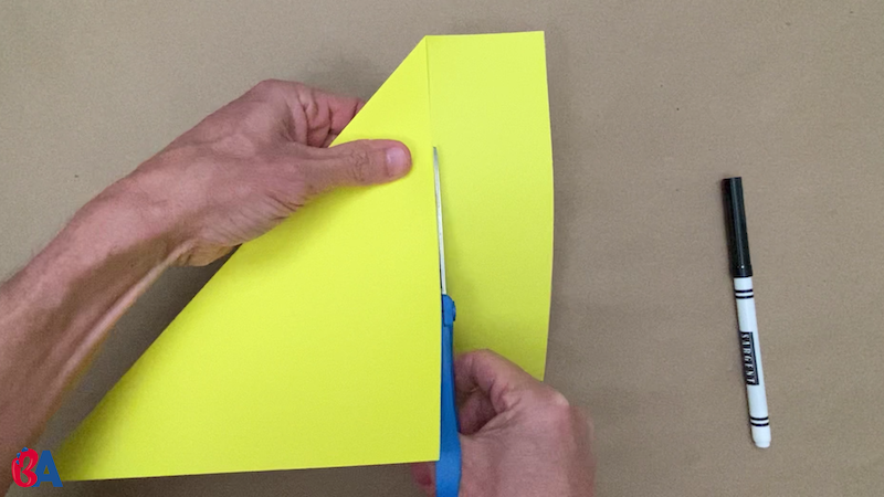Scissors cutting off the extra strip of paper