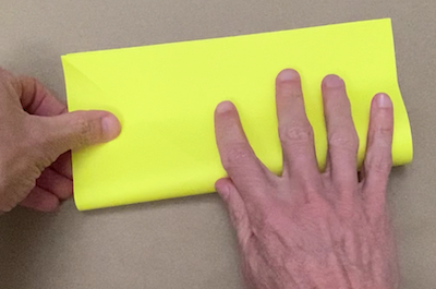 Folding a square of paper in half