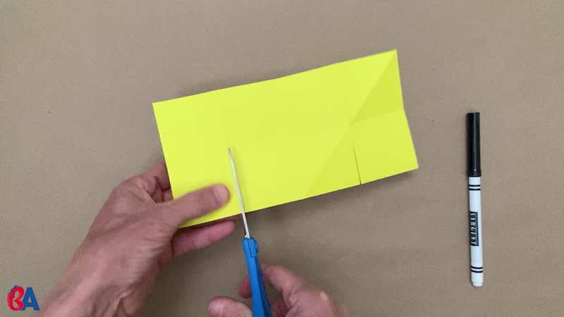 Cutting into a square of paper folded in half