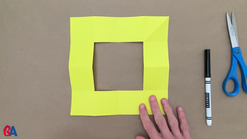 Square of paper with square hole cut out from the center