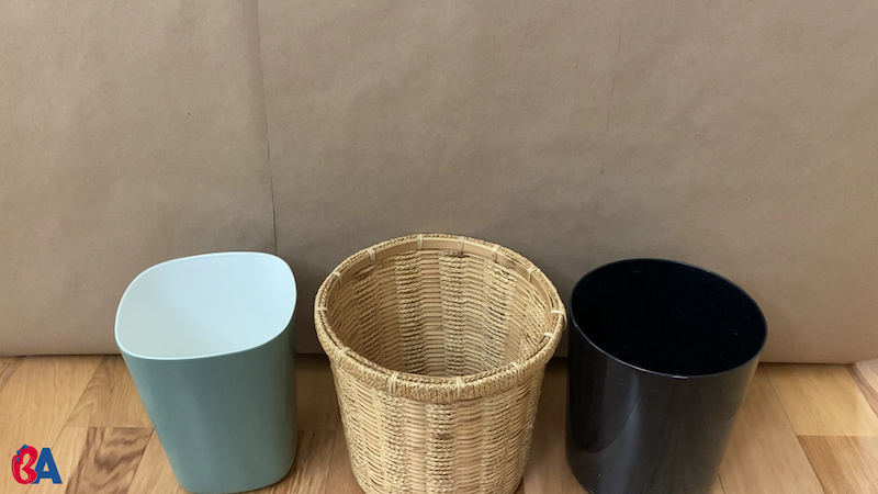 3 waste baskets lined up in a row
