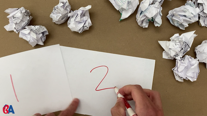 Writing numbers on pieces of paper