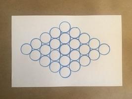 25 circles arranged in a diamond