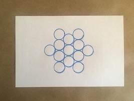 13 circles arranged in a star
